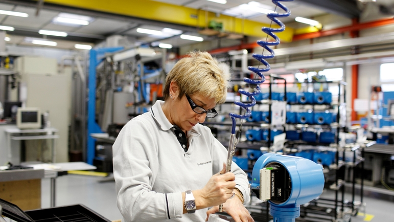 Endress+Hauser Flow in Reinach, Switzerland, woman working in production